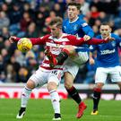 Gers rocked: Hamilton's opening scorer David Templeton holds off Rangers' Josh Windass