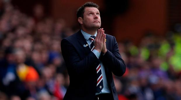 Suffering: Graeme Murty looks to the heavens as Rangers lose to Celtic