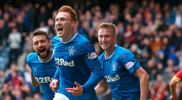 Of the mark: David Bates wheels off in celebration after netting the only goal of the game against Kilmarnock, his first strike for Rangers