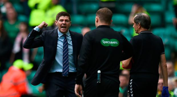 Unhappy man: Steven Gerrard remonstrates with officials