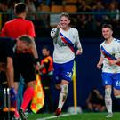 Net gains: Kyle Lafferty sets off in celebration after drawing Rangers level in Spain