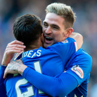 Emphatic win: Daniel Candeias is congratulated by Kyle Lafferty after scoring Rangers' fifth at Ibrox yesterday