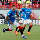 Spot on: James Tavernier celebrates his second successful spot-kick