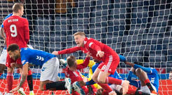 Final shout: Lewis Ferguson beams with delight after putting the ball in Rangers' net