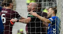 Red mist: Referee Bobby Madden intervenes with a red card following Rangers ace Scott Arfield's shocking challenge on Hearts goalkeeper Zdenek Zlamal