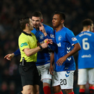 Off colour: Kyle Lafferty remonstrates with referee Steven McLean following Alfredo Morelos' latest red card