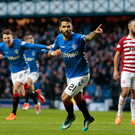 On target: Rangers' Daniel Candeias celebrates finding the net but boss Steven Gerrard wasn't entirely happy with his side's prowess