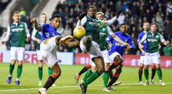 Blocked off: Alfredo Morelos sees his shot charged down by Hibs defender Efe Ambrose