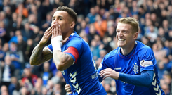 Spot on: James Tavernier celebrates with Steven Davis after his two penalties were enough to see off Aberdeen at Ibrox