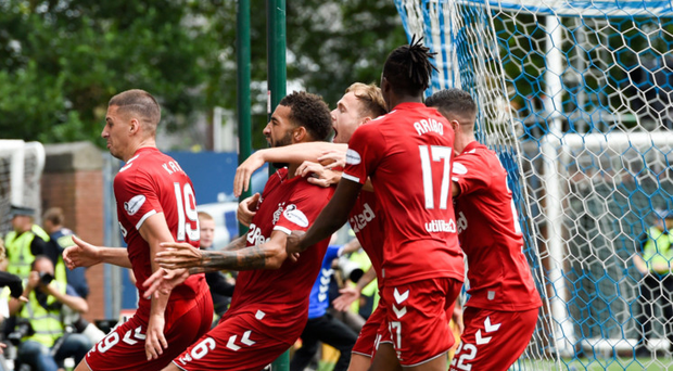 Late delight: Connor Goldson is mobbed after hitting a last-gasp winner for Rangers