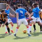 Net gains: Joe Aribo tucks home Rangers' third in their victory over East Fife