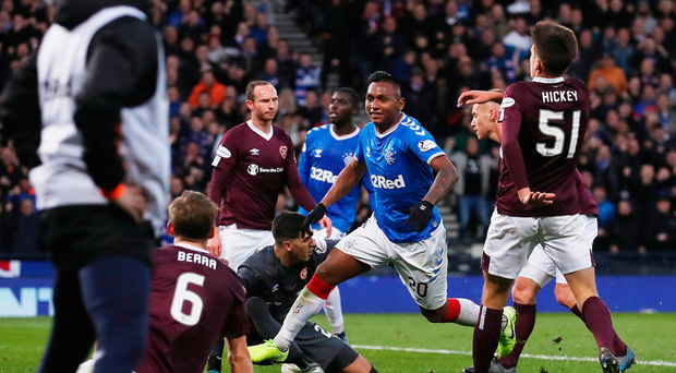 Alfredo Morelos sets off in celebration after scoring his second goal of the game
