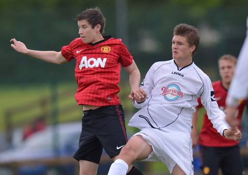 Making progress: A young Paddy McNair takes on Revo Express at Riada Stadium, Ballymoney in the 2012 Milk Cup tournament