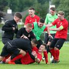Man for the big occasion: Co Antrim's Liam McKenna is mobbed by team-mates after scoring against Club America