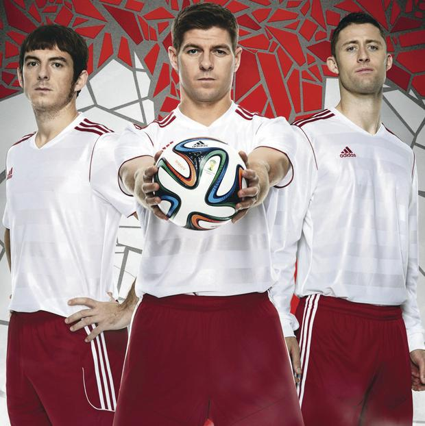 England trio Leighton Baines, Steven Gerrard and Gary Cahill with the Brazuca official World Cup ball