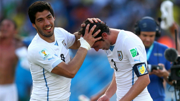 All smiles: Luis Suarez celebrates with match-winner Diego Godin