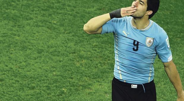 Once bitten: Luis Suarez is in the dock, accused of biting at the World Cup