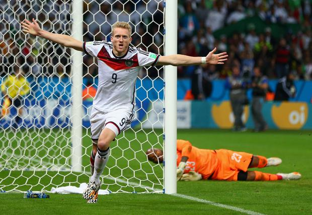 PORTO ALEGRE, BRAZIL - JUNE 30: Andre Schuerrle of Germany celebrates scoring his team's first goal in extra-time past goalkeeper Rais M'Bolhi of Algeria during the 2014 FIFA World Cup Brazil Round of 16 match between Germany and Algeria at Estadio Beira-Rio on June 30, 2014 in Porto Alegre, Brazil. (Photo by Jamie Squire/Getty Images)
