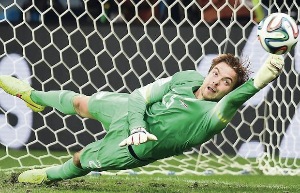 Gamble paid off: Tim Krul, who Luis van Gaal decided to put on for the penalties, saves a spot kick from Costa Rica's Michael Umana in the 2014 World Cup