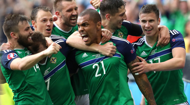 Major impression: Stuart Dallas, Jonny Evans, Gareth McAuley and Josh Magennis surround Niall McGinn after his goal in the 2-0 victory against Ukraine at the Euro 2016 finals in France
