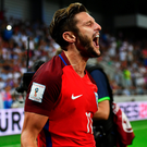 Late joy: Adam Lallana celebrates after scoring England's 95th minute winner against Slovakia