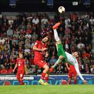 Head over heels: Kyle Lafferty attempts an overhead kick