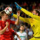 My ball: Michael McGovern goes up with Czech Republic striker Ladislav Krejci during last night's World Cup qualifier in Prague