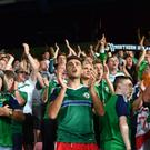 Proud: Supporters cheer Northern Ireland stars on last night in Prague