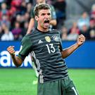 Star man: Muller leads from the front with brace for World Cup winners