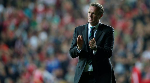 Home comforts: Michael O'Neill wants his men to build on the unbeaten Windsor form that helped them qualify for the Euro finals on the back of inspirational support from the Green and White Army