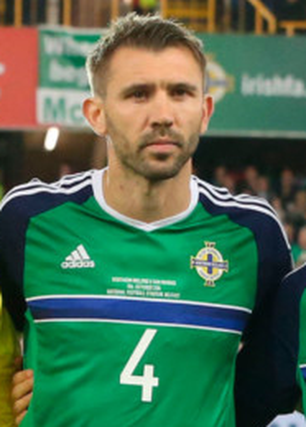 Quick change: Gareth McAuley faces a stiffer examination in Germany
