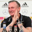Bring it on: Northern Ireland manager Michael O'Neill in confident mood at the Hannover Arena last night
