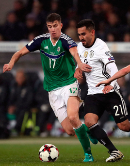 Chasing shadows: IIkay Gundogan gives Paddy McNair the runaround in Hannover on Tuesday night