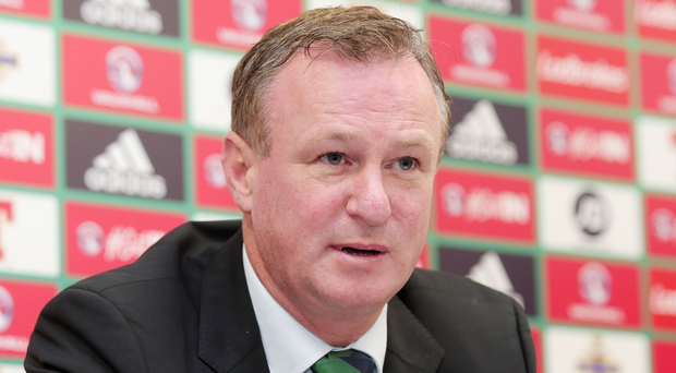 Wary boss: Michael O'Neill at yesterday's press conference