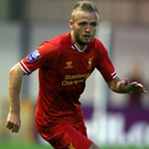 Red alert: Ryan McLaughlin in Liverpool colours