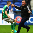 Michael O'Neill celebrates victory over Ukraine at the finals in France