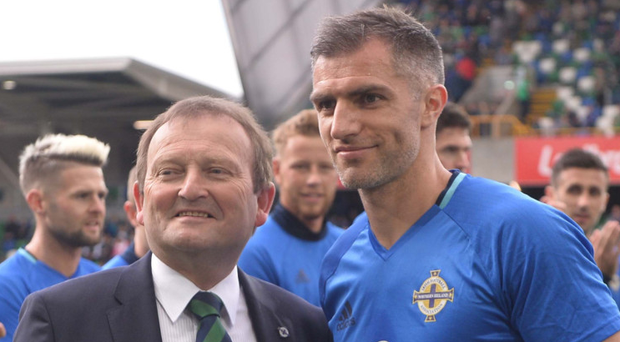 If the cap fits: IFA President David Martin honours Aaron Hughes for a century of NI appearances