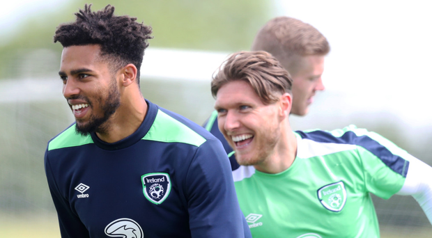 In their stride: Republic of Ireland duo Cyrus Christie and Jeff Hendrick enjoy training yesterday