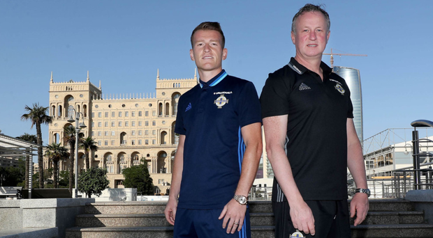 On the road: Northern Ireland manager Michael O'Neill and captain Steven Davis get used to their new surroundings in Baku ahead of tonight's World Cup qualifier against Azerbaijan