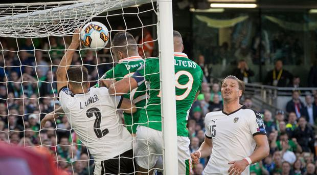 Ruled out: Shane Duffy puts the ball in the back of the Austria net but it was controversially disallowed