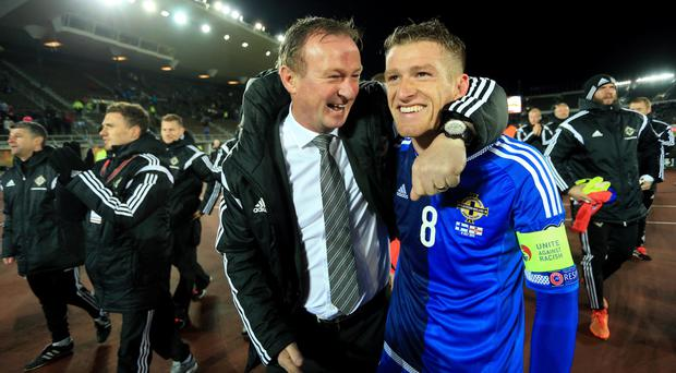 How's about that Steve? Under the stewardship of boss Michael O'Neill (left) and with Steve Davis (right) as captain, Northern Ireland have reached highest ever world ranking place.