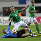Stuck in: Sammy Clingan says Michael O'Neill will have a key role in the play-offs and Steven Davis should be at a top-four club in the Premier League