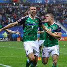 Northern Ireland ace Gareth McAuley celebrates opening the scoring in the victory over Ukraine at the Euro 2016 finals