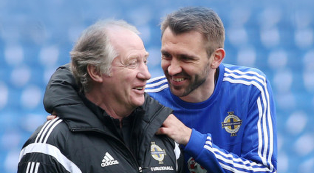 Great team spirit: Northern Ireland assistant manager Jimmy Nicholl with star player Gareth McAuley