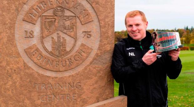 Top boss: Hibernian chief Neil Lennon with his Ladbrokes Premiership Manager of the month award for October