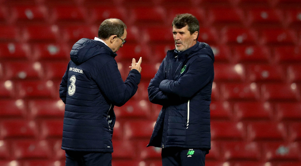 Talking tactics: Republic boss Martin O'Neill (left) and assistant manager Roy Keane take a training session at the Parken Stadium in Copenhagen last nightO'Neill