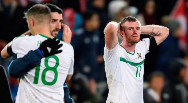 Agonising miss: Chris Brunt lets it all out after the play-off defeat to Switzerland
