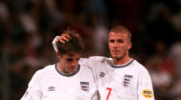 Former defender Phil Neville (left) knows from his experience what the fall-out from an England defeat can be (Nick Potts/EMPICS Sport)