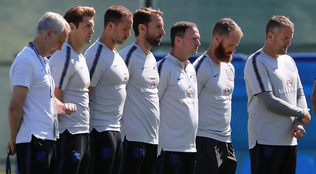 England manager Gareth Southgate, centre, and staff observe a minute's silence to honour the victims of the Grenfell Tower fire (Owen Humphreys/PA)