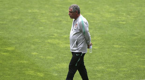 Fernando Santos expects Spain to provide a difficult opener (Armando Franca/AP)